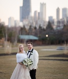 bride in champagne wedding dress with white fur wrap white greenery bouquet groom in white tuxedo