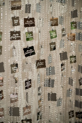 Mirror escort cards attached to crystal strands vertical piece of art unique escort card display