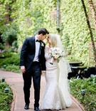 bride in trumpet mermaid fit and flare wedding dress groom in tuxedo bow tie long veil muted bouquet