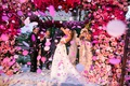 wedding ceremony kiss with pink confetti pink flowers chuppah first kiss