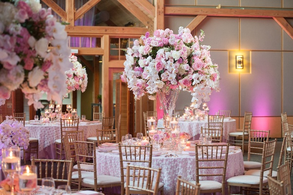 Round tables topped with fresh flowers and crystals