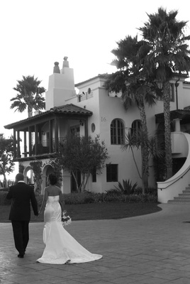 Bride and groom walk towards Bacara Resort & Spa