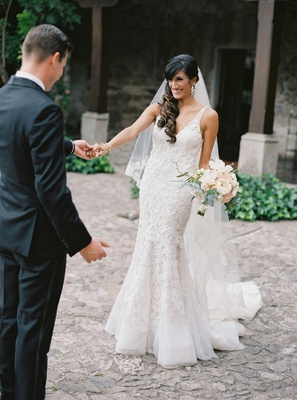 first look for couple destination wedding antigua guatemala bride in liancarlo spanish lace dress
