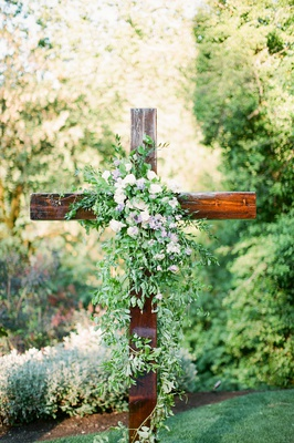 la rams brandin cooks briannon lepman wedding, ceremony altar wooden cross greenery with some flower
