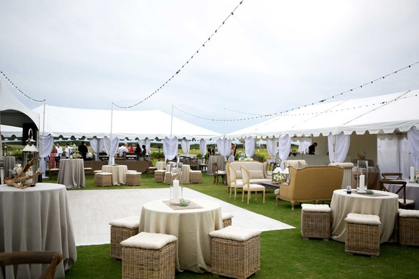 wedding reception lounge space dance floor alfresco seaside cloudy wicker champagne colored lights