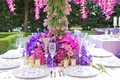 Wedding reception floral tree centerpiece surrounded by purple, fuchsia vanda orchids, mauve roses