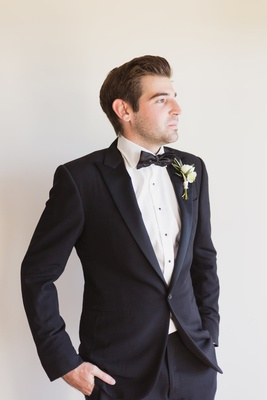 groom in ralph lauren purple label suit with hands in pocket, groom's portrait in profile