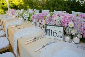 Silver-framed table number with yearbook photos