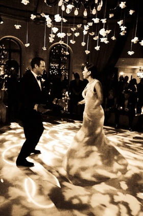 Sepia tone image of bride and groom first dance
