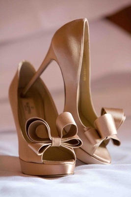 Champagne-colored peep-toe pumps