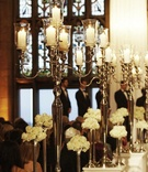 Silver candle holders on white pedestals