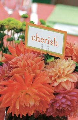 Cherish table name idea on bed of orange dahlias
