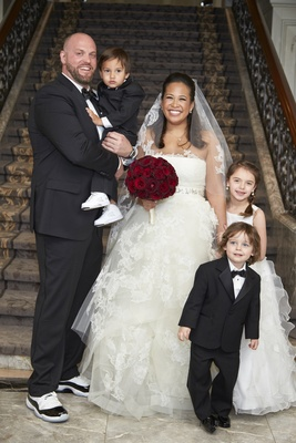 bride in vera wang lace ball gown wedding dress and veil, groom in sneakers, ring bearer flower girl