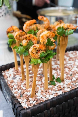 Cajun shrimp on wood fork for wedding appetizers