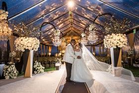 Wedding ceremony tent original runner company aisle runner clear tent flower chandelier twilight