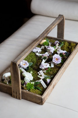 Wedding flowers boutonniere blooms on moss lined tray wood rustic look