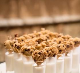 heart-shaped chocolate chip cookies garnishing glasses of milk