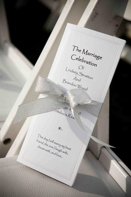 Silver ribbon around rectangular ceremony booklet