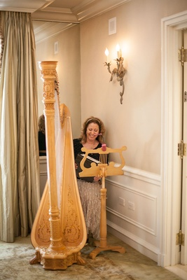 Woman playing harp at the Magnolia Room bridal shower at Peninsula Beverly Hills