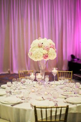 pink peonies, white roses, white hydrangeas centerpieces on glass stand