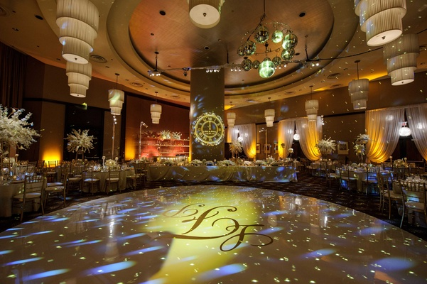 clock and monogram projections for new year's eve wedding