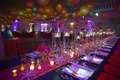 Japanese lanterns above dance floor and tables