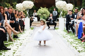 adorable flower girl with baby's breath flower crown and large white tulle skirt