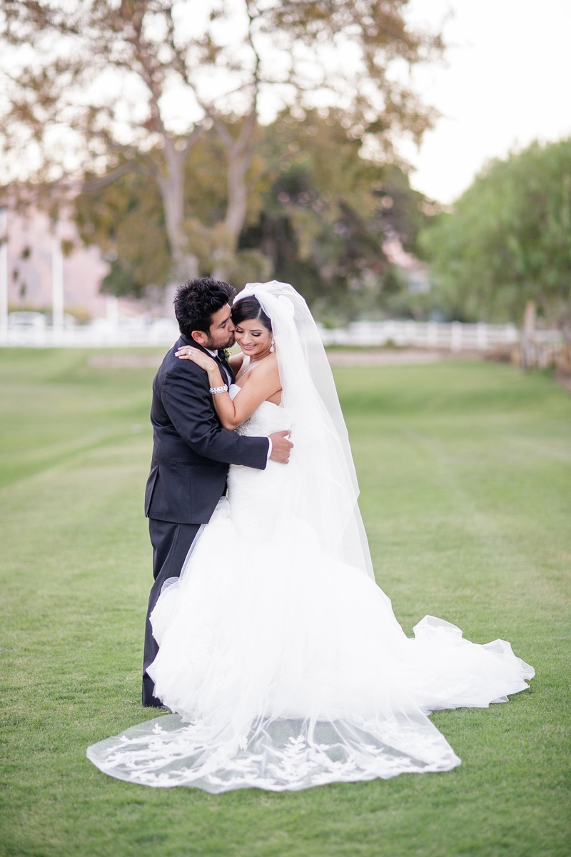 Bride and groom in grass after wedding ceremony