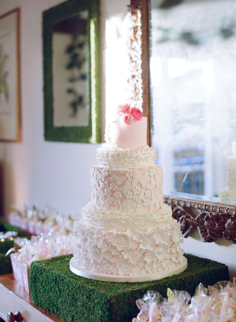 White and pink wedding cake for Brette Wolff and Adam Ottavino with lace details
