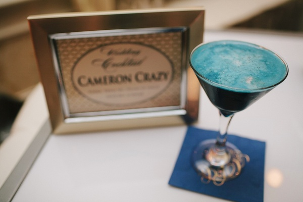 Signature blue wedding cocktail in martini glass