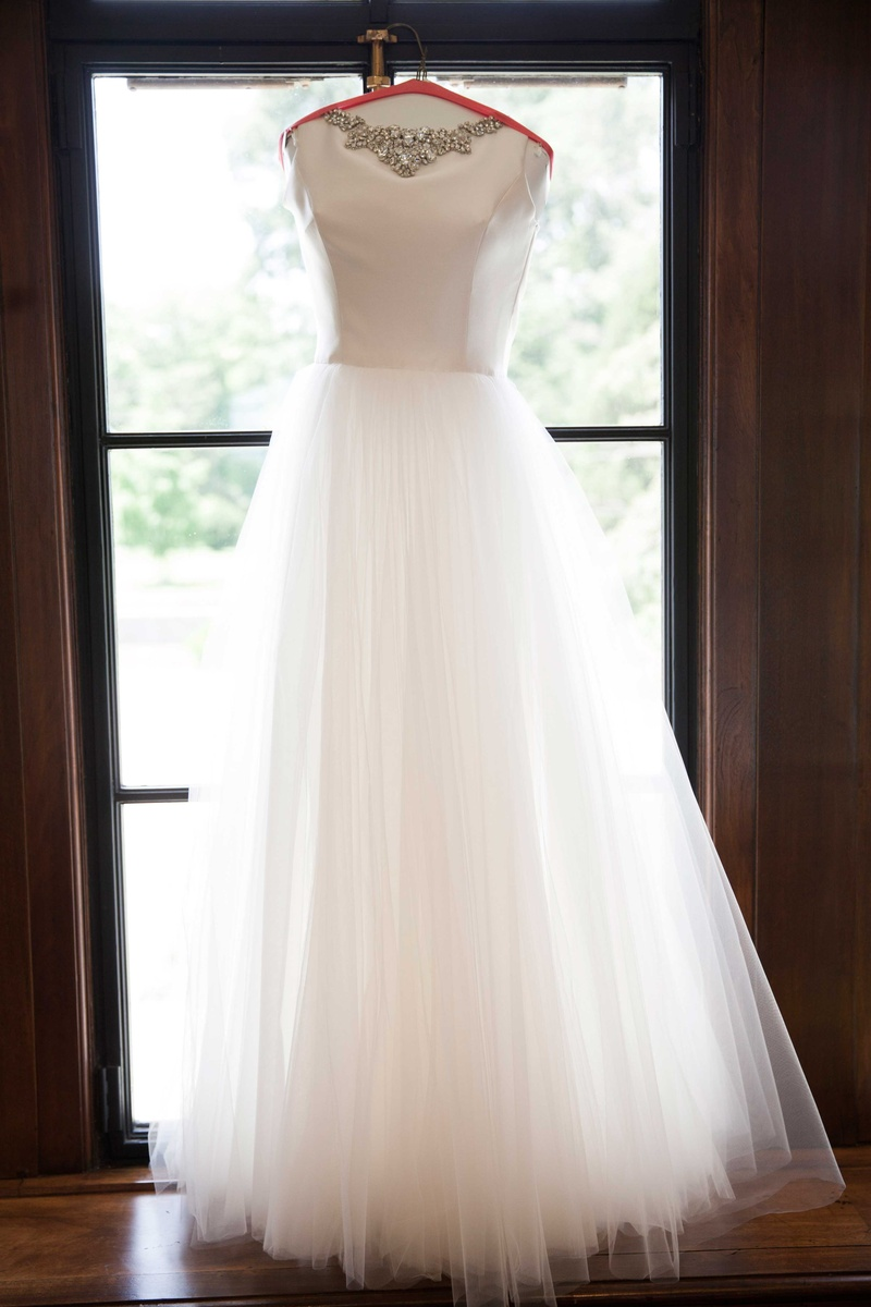 this flowing gown complete with a full tulle skirt was the brides second dress of the evening