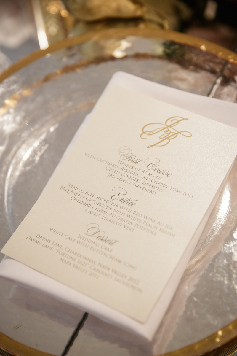 Ivory wedding reception menu for three-course meal couple's monogram in gold