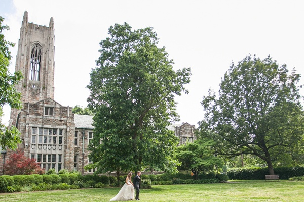 a bride and groom walk across the grass lawn outside a church in Nashville Tennessee
