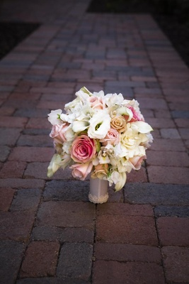 Rose, calla lily, and orchid wedding bouquet
