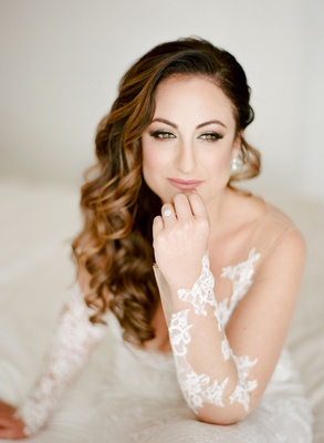 Bride in Ines Di Santo wedding dress long curly brown hair swept to side over crown pretty makeup