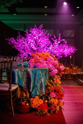 Cascading pink and orange flowers and LED trees