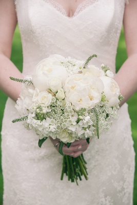 Bride carrying white peonies and Queen Anne's lace