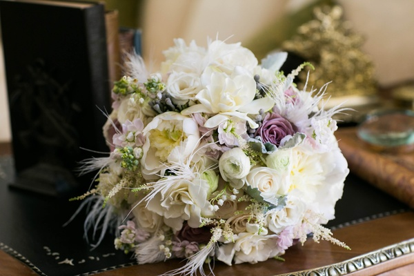 Purple, green, and ivory wedding bouquet with feathers