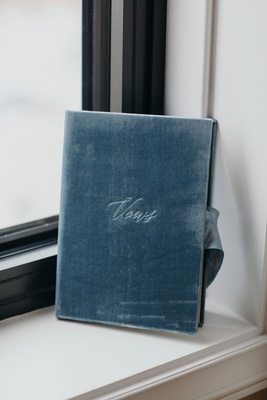 Suzanna Villarreal and Alex Wood LA Dodgers wedding something blue velvet vows book with ribbon
