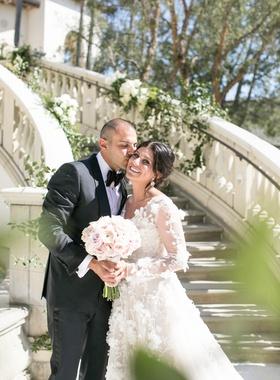 Bride in long sleeve floral applique wedding dress mark ingram atelier groom in tom ford tuxedo
