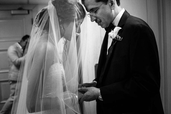 black and white photo of father of the groom and bride before ceremony