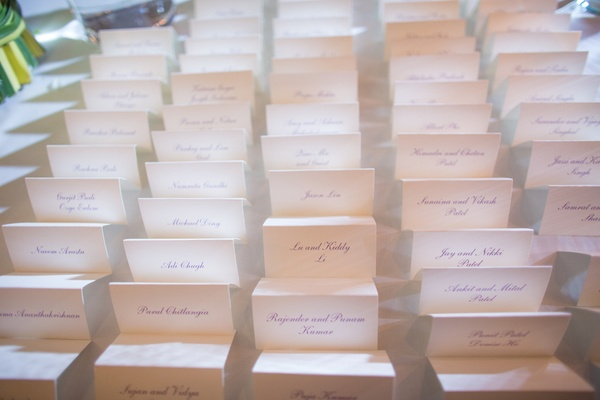 Wedding place cards with names written in purple script