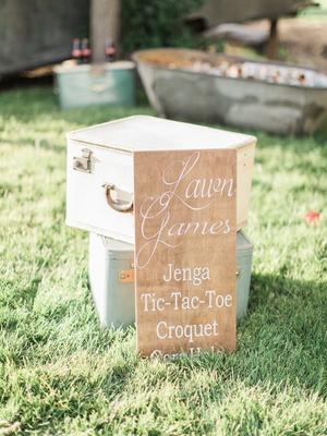 wood sign denoting games california boho chic wedding styled shoot rustic fun