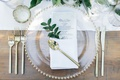 Jillian Murray and Dean Geyer wedding reception place setting wood table white runner gold flatware