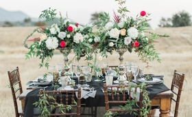 dark reception table hillside styled shoot black linen wood chairs vases red white green california