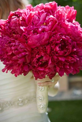 Hot pink wedding bouquet with blooming peonies