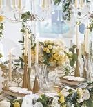 gold hourglass shaped candlesticks at wedding reception, modern gold candlesticks