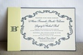 White navy wedding invitation with yellow belly band b squared logo monogram
