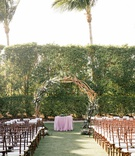 wedding ceremony wood chairs white cushion purple linen circle branch greenery purple flowers unique