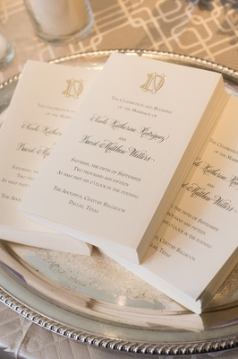 formal ceremony programs with monogram displayed on silver tray